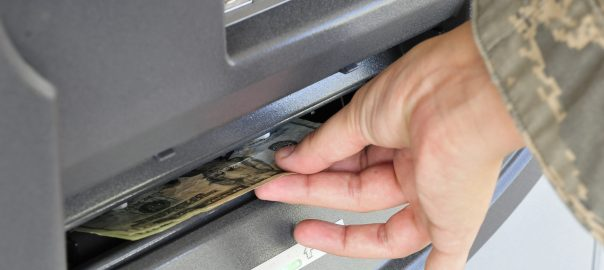U.S. Air Force 1st Lt. Mary Work of the 27th Special Operations Security Forces Squadron and chairwoman of the Quality of Life Council draws money from an automatic teller machine at the Cannon Air Force Base dining facility, June 30, 2010. The ATM was a convenience requested by base personnel and secured by the Quality of Life Council. (US Air Force Photo by Tech. Sgt. Josef Cole)